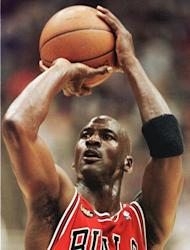 Michael Jordan, shown playing for the Chicago Bulls in 1998. Jordan turned high-leaping slam dunks, clutch game-winning baskets and defensive determination into performance art for the Chicago Bulls, leading them to NBA titles from 1991-1993 and 1996-1998 with a retirement in between