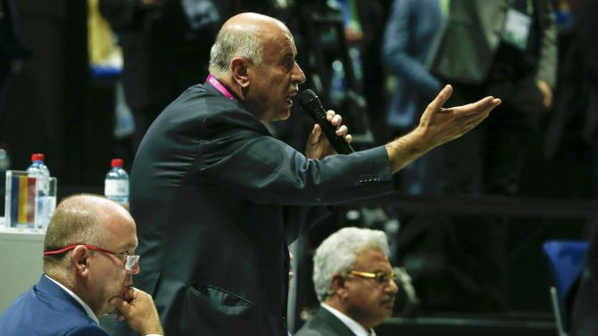 Al Rajoub, President of Palestinian Football Association, stands as he gestures at the 65th FIFA Congress in Zurich