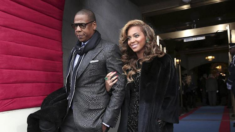 FILE - This Jan. 21, 2013 file photo shows recording artists Jay-Z and Beyonce at the Capitol in Washington for the Presidential Barack Obama's ceremonial swearing-in ceremony during the 57th Presidential Inauguration. The couple named their daughter, born Jan. 7, 2012, Ivy Blue. (AP Photo/Win McNamee, Pool, file)
