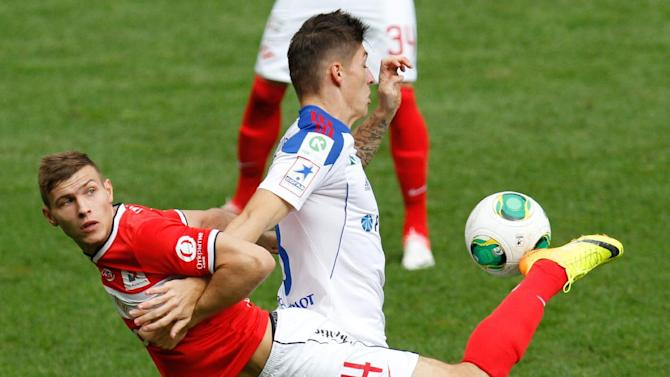 Spartak's Sergei Parshivlyuk , left, vies for the ball with CSKA Moscow's Steven Zuber during a Russian Premier League Championship soccer match between CSKA Moscow and Spartak Moscow at the Lokomotiv stadium in Moscow, Russia, Sunday, Sept. 22, 2013. Spartak won 3-0
