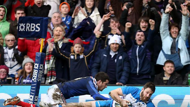 Scotland's Tommy Seymour, right, scores his try ahead of France's Brice Dulin, left, during their Six Nations rugby union international match at Murrayfield in Edinburgh, Scotland, Saturday March 8, 2014. (AP Photo/Scott Heppell)