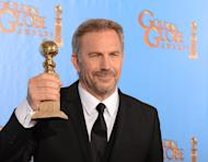 """Kevin Costner poses in the press room with his Best performance by an actor in a mini-series or motion picture made for television award for """"Hatfields & McCoys"""" at the Golden Globe awards ceremony in Beverly Hills on January 13, 2013"""