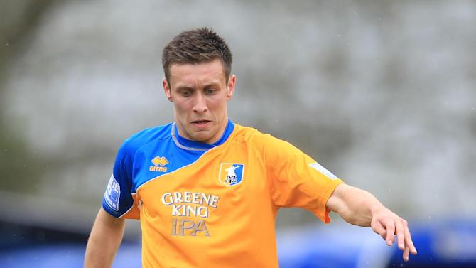 Burnley boss Eddie Howe has signed Luke O'Neill (pictured) on a two-year deal from Mansfield