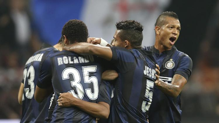 Inter Milan Brazilian defender Cicero Jonathan, covered by his teammates, celebrates after scoring during the Serie A soccer match between Inter Milan and Hellas Verona at the San Siro stadium in Milan, Italy, Saturday, Oct. 26, 2013