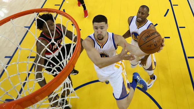 Golden State Warriors' Klay Thompson (11) drives to the basket during the first half of Game 2 of a second-round NBA basketball playoff series against the Portland Trail Blazers Tuesday, May 3, 2016, in Oakland, Calif. (AP Photo/Ezra Shaw, Getty Images via AP, Pool)