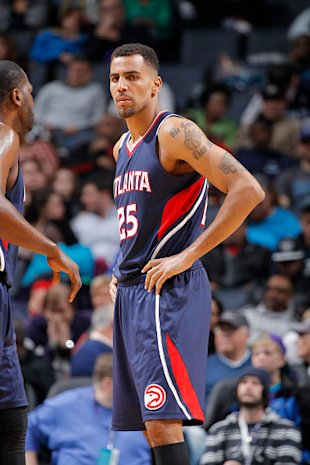CHARLOTTE, NC - MARCH 28: Thabo Sefolosha #25 of the Atlanta Hawks looks on during the game against the Charlotte Hornets on March 28, 2015 at Time Warner Cable Arena in Charlotte, North Carolina. (Photo by Rocky Widner/Getty Images)