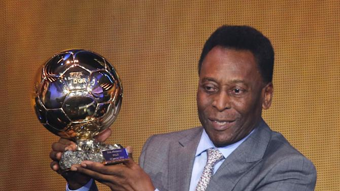 Brazil's soccer legend Pele displays the honorary prize he received at the FIFA Ballon d'Or 2013 Gala in Zurich, Switzerland, Monday, Jan. 13, 2014