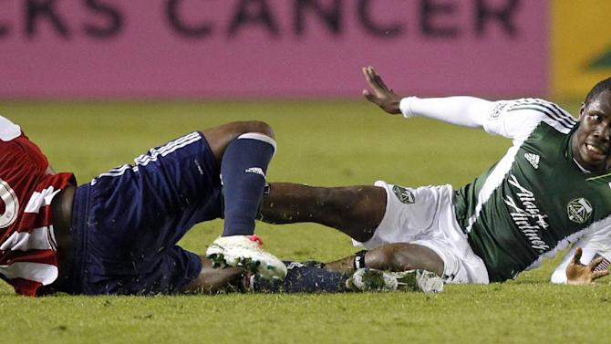 Portland Timbers midfielder Kalif Alhassan, right, battles for the ball with Chivas USA midfielder Oswaldo Minda (30) during the second half of an MLS soccer match, Saturday, Oct. 26, 2013, in Carson, Calif. Timbers won the match 5-0