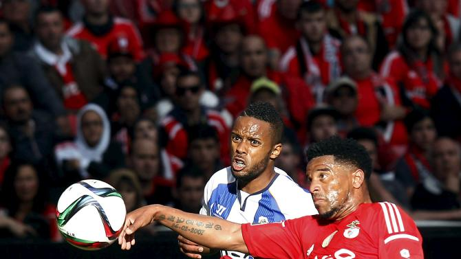 Benfica's Eliseu Santos fights for the ball with Porto's Hernani Fortes during their Portuguese Premier League soccer match at Luz stadium in Lisbon