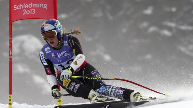 United States' Lindsey Vonn speeds down the course during the women's super-G course, at the Alpine skiing world championships in Schladming, Austria, Tuesday, Feb.5, 2013. (AP Photo/Luca Bruno)