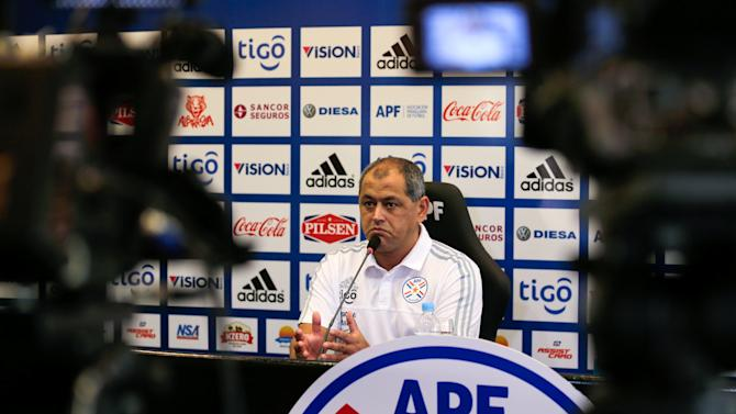 Paraguay national soccer team coach Arce speaks during a news conference in Ypane