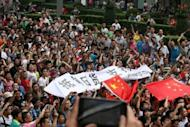 Protesters take part in a demonstration in Chengdu in China's Sichuan province against Japan's claim of the Diaoyu islands on August 19. Anti-Japan protests broke out on August 19 in more than a dozen Chinese cities as authorities allowed thousands of people to vent anger over an escalating territorial row