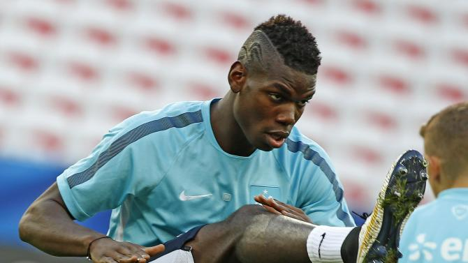 France's national soccer player Paul Pogba attends a training session at Allianz Riviera stadium in Nice