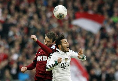 Bayern Munich's Thaigo heads ball with Feulner of Nuremberg during their German first division Bundesliga soccer match in Nuremberg