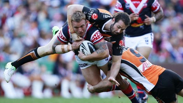 Jake Friend of the Roosters is tackled over the top by Aaron Woods of the Tigers during the round 25 NRL match between the Sydney Roosters and the Wests Tigers at Allianz Stadium on August 26, 2012 in Sydney, Australia. (Photo by Matt King/Getty Images)