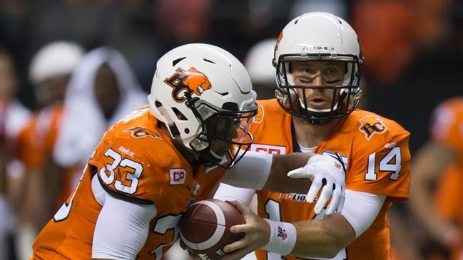 B.C. Lions' quarterback Travis Lulay, right, hands off to Andrew Harris during the first half of a CFL football game against the Toronto Argonauts in Vancouver, B.C., on Friday July 24, 2015. A roller-coaster start to the CFL season has the Lions searching for consistency. THE CANADIAN PRESS/Darryl Dyck