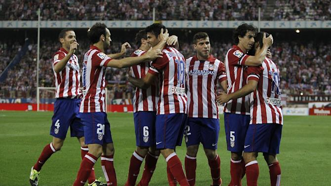 Atletico de Madrid's Diego Costa from Brazil, fourth left, celebrates his goal with team mates during a Spanish La Liga soccer match against Osasuna at the Vicente Calderon stadium in Madrid, Spain, Tuesday, Sept. 24, 2013