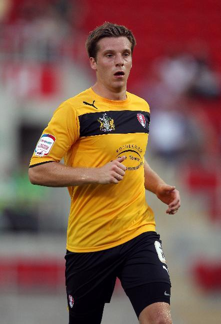 Johnny Mullins, pictured, has been encouraged to move closer to Rotherham by manager Steve Evans