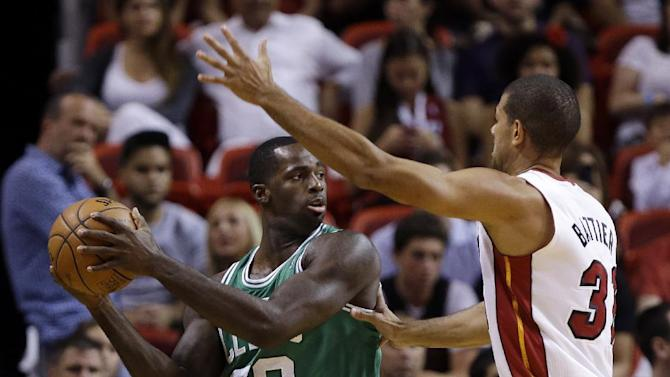 Boston Celtics' Brandon Bass (30) looks to pass as Miami Heat's Shane Battier defends during the first half of an NBA basketball game Saturday, Nov. 9, 2013, in Miami