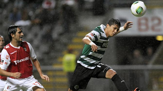 Sporting's Fredy Montero, from Colombia, heads for the ball past Sporting Braga's Custodio Castro, left, during their Portuguese League soccer match at the Municipal Stadium, in Braga, Portugal, Saturday Sept. 26, 2013. Montero scored once in Sporting's 2-1 victory