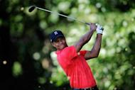 Tiger Woods tees off on the 14th hole during the Final Round of the AT&T National on July 1. Woods won the event for his 74th career title to pass Jack Nicklaus for second place all-time on the PGA Tour list