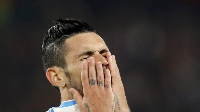Olympique Marseille's Cabella reacts at the end of his French Ligue 1 soccer match against Paris St Germain at the Parc des Princes stadium in Paris