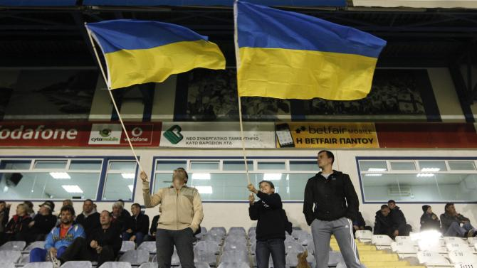 Ukraine's fans wave national flags before an international friendly soccer match against the U.S in Larnaca