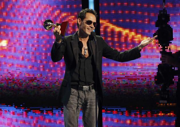 "Marc Anthony accepts the award for record of the year for ""Vivir Mi Vida"" onstage during the 14th Latin Grammy Awards in Las Vegas"