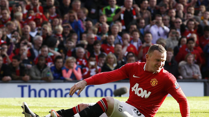 Manchester United's Wayne Rooney reacts after missing a penalty against Chelsea during their English Premier League soccer match at Old Trafford, Manchester, England, Sunday Sept. 18, 2011. (AP Photo/Jon Super)