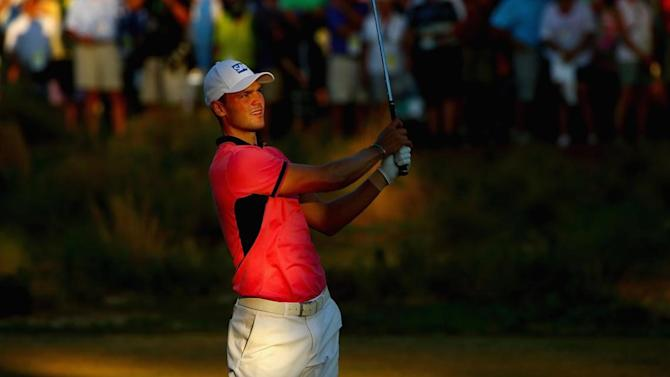 Golf - Kaymer survives wobbles to take five-shot lead into finale