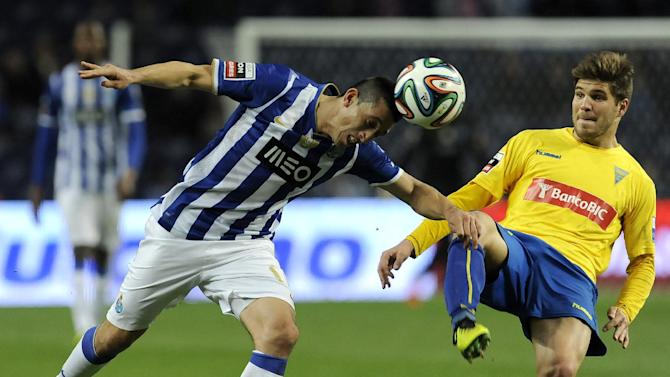 FC Porto's Hector Herrera, from Mexico, heads the ball past Estoril's Diogo Amado, right, in a Portuguese League soccer match at the Dragao stadium, in Porto, Portugal, Sunday, Feb. 23, 2014. Porto lost 1-0