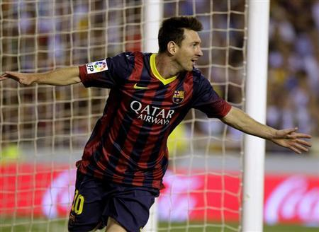 Barcelona's Messi celebrates scoring against Valencia during their Spanish first division match in Valencia
