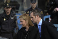 FILE - In this Feb. 9, 2016 file photo, Spain's Princess Cristina and her husband Inaki Urdangarin, leave a courtroom after attending a corruption trial, in Palma de Mallorca, Spain. A Spanish court on Friday Feb. 17, 2017, found Princess Cristina not guilty in a tax fraud case in which her husband, the brother-in-law of King Felipe VI, was sentenced Friday to 6 years and 3 months in prison for evading taxes, fraud and various other charges. (AP Photo/Joan Llado, File)