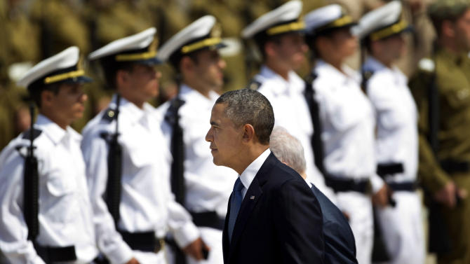 US President Barack Obama reviews an honor guard upon his arrival at Ben Gurion airport near Tel Aviv, Israel, Wednesday, March 20, 2013. President Barack Obama is declaring common cause with Israel, highlighting the bonds between the United States and its Mideast ally. He says he has made Israel the first stop of the first trip of his second term to restate his commitment to Israel's security. (AP Photo/Ariel Schalit)