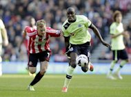 Sunderland's Swedish midfielder Sebastian Larsson (left) vies with Newcastle United striker Demba Ba during their English FA Premier League football match in Sunderland. Sunderland rescued a 1-1 draw against 10-man Newcastle as Ba's late own goal cost his team a victory over their bitter rivals