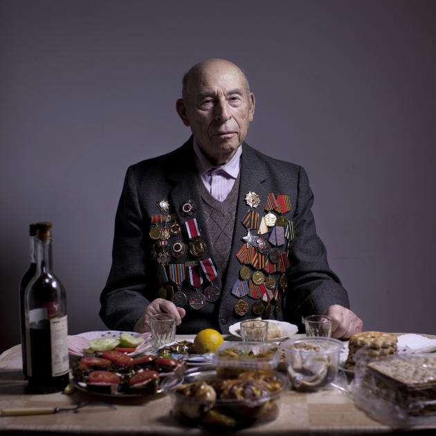In this photo made Thursday, April 11, 2013, Soviet Jewish World War Two veteran Boris Ginsburg poses for a portrait at his house in the southern Israeli city of Ashdod. Ginsburg, born in Belorussia,