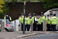 Police officers man a cordoned off area in Woolwich, east London, on May 22, 2013.