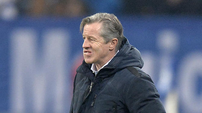 Schalke head coach Jens Keller looks disappointed after his team received the third goal before halftime during the German soccer cup third round match between FC Schalke 04 and TSG Hoffenheim in Gelsenkirchen, Germany, Tuesday, Dec. 3, 2013