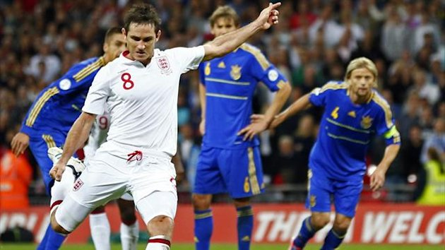 England's Lampard scores a penalty against Ukraine during their 2014 World Cup qualifying match at Wembley stadium in London (Reuters)