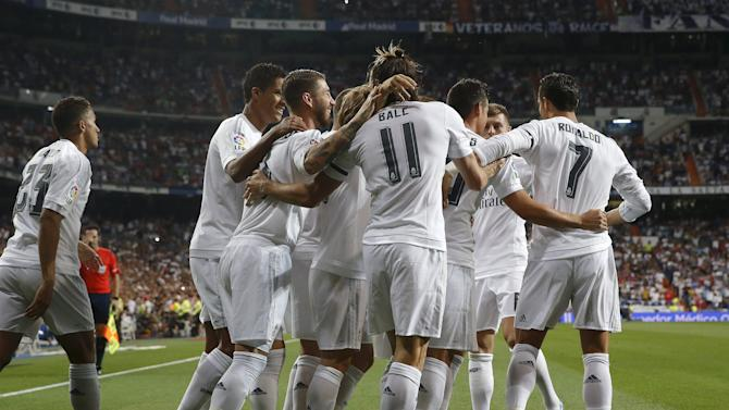 Real Madrid players celebrate Gareth Bale's goal against Real Betis during their Spanish first division soccer match at Santiago Bernabeu stadium in Madrid, Spain