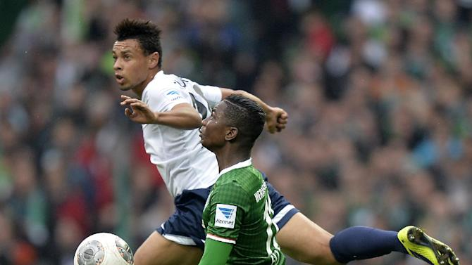Freiburg's Francis Coquelin of France, top, and Bremen's Eljero Elia of the Netherlands challenge for the ball during the German first division Bundesliga soccer match between Werder Bremen and SC Freiburg in Bremen, Germany, Saturday, Oct. 19, 2013