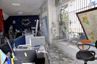 Damage inside a travel agency on Boulevard du 30 Juin in Kinshasa following a series of blasts at a munition depot across the Congo River in the Congolese capital Brazzaville