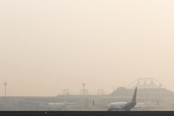 PALEMBANG, Aug. 29, 2015 (Xinhua) -- Planes are seen in thick haze at Sultan Mahmud Baddarudin II airport in Palembang, Indonesia, Aug. 29, 2015. A thick haze fills the air of South Sumatra provincial