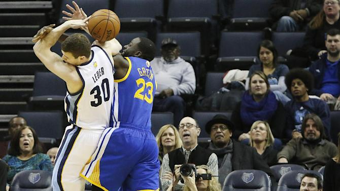 Memphis Grizzlies forward Jon Leuer (30) and Golden State forward Draymond Green (23) fight for a loose ball in the first half of an NBA basketball game Saturday, Dec. 7, 2013, in Memphis, Tenn