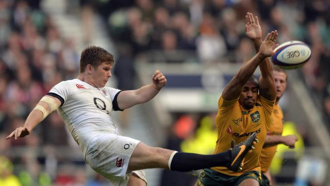 England's Farrell clears the ball as Australia's Genia attempts to block the kick during their international rugby union test match in London