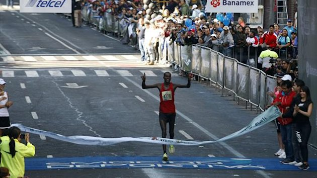 Peter Lemayian Knaya of Kenya celebrates as he crosses the finish line to win the XXX International Marathon in Mexico City (Reuters)