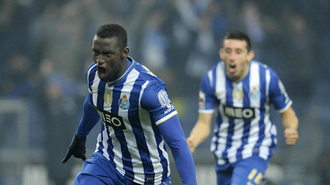 FC Porto's Jackson Martinez, from Colombia, celebrates with Hector Herrera from Mexico, rear, after scoring the opening goal against Sporting Braga in a Portuguese League soccer match at the Dragao Stadium in Porto, Portugal, Saturday, Dec. 7, 2013