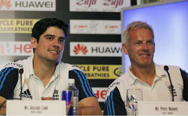 FILE - In this Thursday, Nov. 20, 2014 file photo, England's cricket captain Alastair Cook, left, and team coach Peter Moores listen to a question during a press conference ahead of their one day