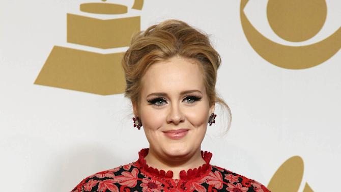 Adele poses backstage with the award for best pop solo performance for