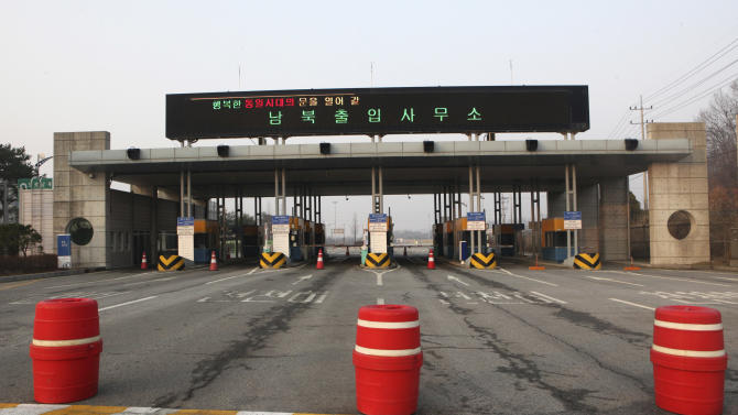 """The gateways to the North Korea's city of Kaesong are shut down at the Inter-Korean Transit Office in Paju, South Korea, near the border village of Panmunjom, Thursday, April 4, 2013. North Korea on Wednesday barred South Korean workers from entering a jointly run factory park just over the heavily armed border in the North, officials in Seoul said, a day after Pyongyang announced it would restart its long-shuttered plutonium reactor and increase production of nuclear weapons material. The letters at top read """" Inter-Korean Transit Office."""" (AP Photo/Ahn Young-joon)"""